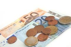 Billetes de banco y monedas euro, centavo, dinero euro en el fondo blanco Imágenes de archivo libres de regalías