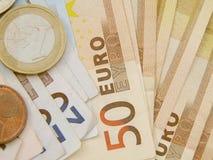 Billetes de banco y monedas euro del dinero en circulación Imágenes de archivo libres de regalías