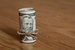 Billetes de dólar del americano cincuenta rodados para arriba Foto de archivo libre de regalías