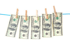 Billetes de dólar que se secan en una cuerda Imagenes de archivo