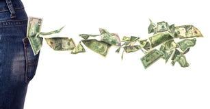 Billetes de dólar que caen del bolsillo Fotos de archivo