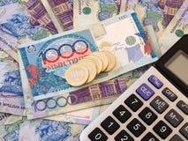 Billetes del calculadora y en Kazakhstan Foto de archivo libre de regalías