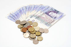 Billetes y monedas del dinero del sterling británico Fotografía de archivo