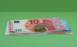 Billetes y monedas euro, unión europea Imágenes de archivo libres de regalías