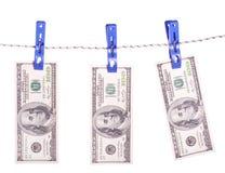 Billets d'un dollar accrochant sur la corde attachée avec des pinces à linge Photo libre de droits