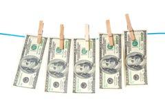 Billets d'un dollar séchant sur une corde Images stock