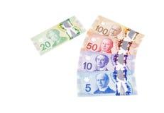 Billets d'un dollar canadiens colorés dans la diverse dénomination 2 Photographie stock
