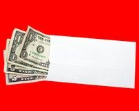 Billets d'un dollar dans l'enveloppe blanc Image stock