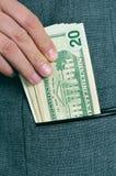 Billets d'un dollar dans la poche Photos libres de droits