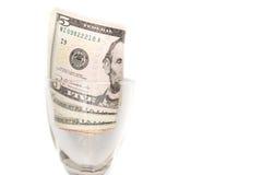 Billets d'un dollar en verre sur le fond blanc Photo stock