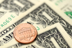 Billets d'un dollar et penny Images stock