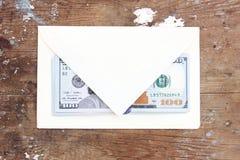 Billets d'un dollar ou argent avec l'enveloppe Photographie stock