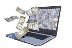 Billets d'un dollar pilotant à l'extérieur l'ordinateur portable Image stock