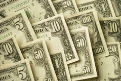 Billets de banque américains de diverses dénominations d'argent liquide Photographie stock libre de droits