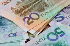 Billets de banque chinois de yuans (renminbi) pour l'argent et le conce d'affaires Images libres de droits