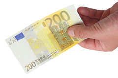 Billets de banque dans sa main Photos stock