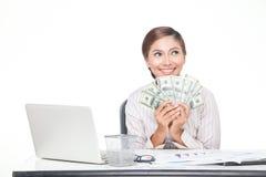 billets de banque des USA de prise de femme d'affaires à disposition Photo libre de droits