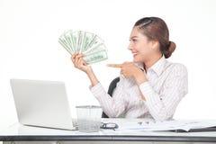billets de banque des USA de prise de femme d'affaires à disposition Images libres de droits