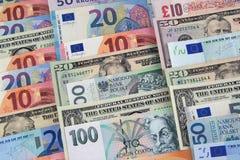 Billets de banque de différents pays photographie stock libre de droits