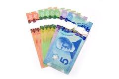 Billets de banque du dollar canadien d'isolement sur le blanc Images libres de droits