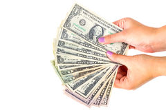 Billets de banque du dollar dans la main femelle Photos stock