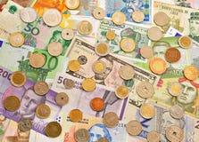 Billets de banque et pièces de monnaie photo stock