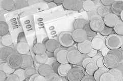 Billets de banque et pièces de monnaie de devise de baht thaïlandais Photo stock