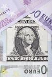 Billets de banque euro et dollar sous forme de maison Images stock