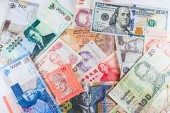 Billets de banque multiples de devises en tant que fond coloré Image stock