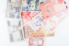 Billets de banque multiples de devises en tant que fond coloré Images libres de droits