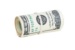 Billets de banque roulés de 100 dollars Image libre de droits