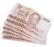 Billets de banque thaïlandais sur le blanc Image stock