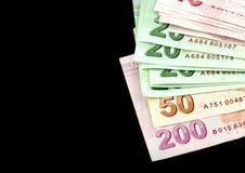Billets de banque turcs Lire turque (TL) sur le fond noir Images libres de droits