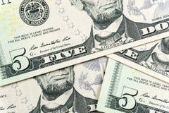 Billets de cinq dollars avec la tête de lincolns images libres de droits