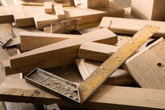 Billets of wood for furniture lie on a workbench Royalty Free Stock Photo