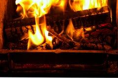 Billettes et branchements en flammes. Photo stock