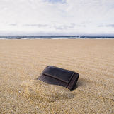 Billfold on the beach over the sand Royalty Free Stock Images