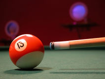 Billiard 1. Billiard-cue ready for the lucky stroke (red ball with number 13 on it royalty free stock photos