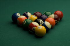 Billiard. Image of billiard balls on the pool table with a person's hand ready to break the balls Stock Image