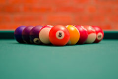 Billiard. Balls and stick to the billiard on the table Royalty Free Stock Image