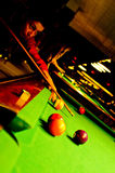 Billiard. Girl in a club  hitting billiard balls Royalty Free Stock Images
