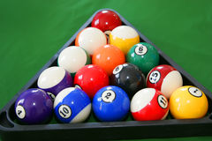 Billiard. Triangle with billiard balls on the green table Stock Photography