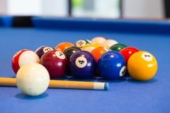 Billiard ball on blue table Royalty Free Stock Photos