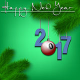 Billiard ball and 2017 on a Christmas tree branch. Happy New Year and numbers 2017 and bowling ball as a Christmas decorations hanging on a Christmas tree branch Stock Photography