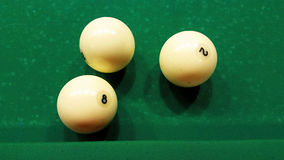 Billiard ball on the cloth. Ivory billiard ball on the green cloth of the table to play Stock Images