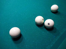 Billiard ball on the cloth. Ivory billiard ball on the green cloth of the table to play Stock Image