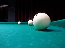 Billiard ball on the cloth. Ivory billiard ball on the green cloth of the table to play Royalty Free Stock Photo