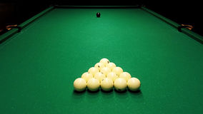 Billiard ball on the cloth. Ivory billiard ball on the green cloth of the table to play Royalty Free Stock Photos