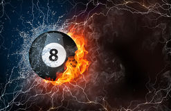 Billiard ball in fire and water. Billiard ball on fire and water with lightening around on black background. Horizontal layout with text space Royalty Free Stock Photos