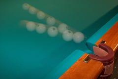 Billiard ball - motion. Billiard ball flying in a billiard pocket Stock Photo